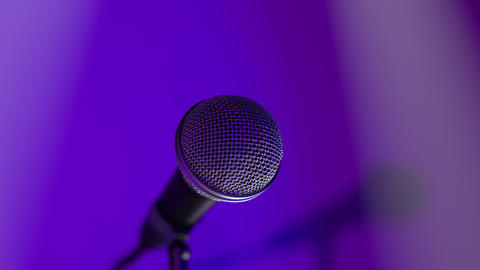 Concert microphone on the music hall stage in the stage lights and spotlight Live Action