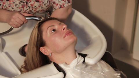 Hair washing at a hairdressing salon Live Action
