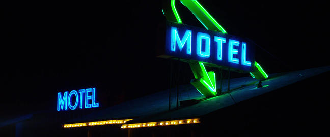 A colorful flashing and neon sing on the Bar, Dinner, Motel, Hotel. Flashing ill Live Action