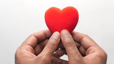 man hand with heart on white background. the concept of take care of health Live Action