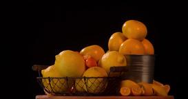 Still life fruits citrus orange rotation 4k looped video intro on black backgrou Footage