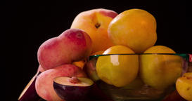 Still life peach plum fruits jam rotation 4k looped video intro copy space Footage