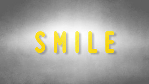 Smile headband. Text from sand. With black background Animation