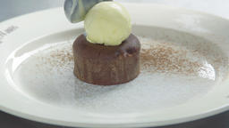 Chef serving chocolate dessert ice-cream scoop 4k video restaurant cake plate Footage