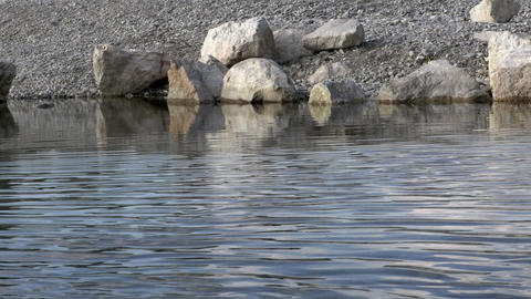Ripples on the water surface. Stones in water Footage