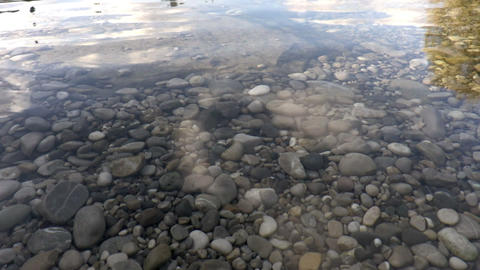 Ripples on the water surface. Stones under water Footage