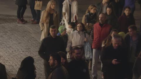People walking on street at night. Munich Marienplatz shopping area 19 Nov 2016  Footage