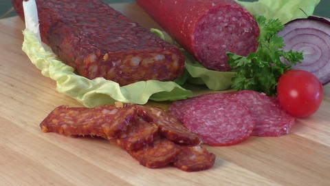 Sausage of salami on a cutting board. Cold appetizer. Cold cuts Live Action