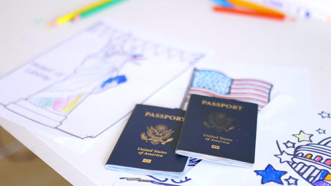Two American passports above images of American patriotic symbols Live Action