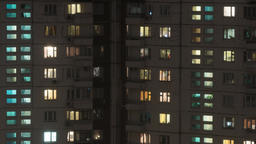 Time lapse shot of buildings and lighted windows at night Footage