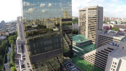 airplane view on city reflection in mirror facade of building Footage