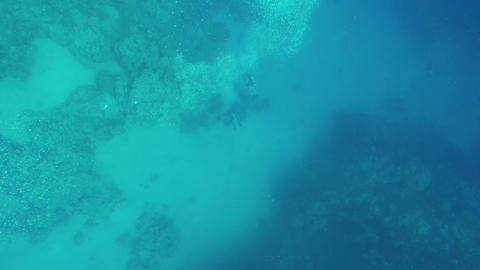 divers under water bubbles releasing, 4k Footage