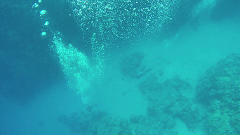 diver under water bubbles releasing, 4k Footage