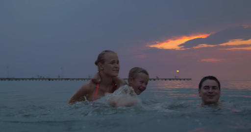At sunset mother with son swimming in sea of city Perea, Greece Footage