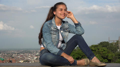 Teen Girl Sitting And Thinking Or Daydreaming Footage