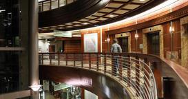 Cancer hospital night acute care elevator man walk away DCI 4K 400 Image
