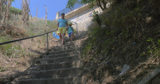 In city Perea, Greece in park down the stairs father with his son Footage