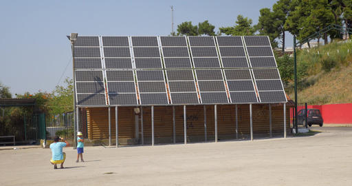 In city Perea, Greece father photographed his son near solar panels Footage
