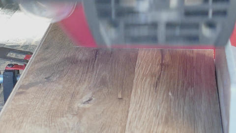 Power chop saw cutting laminated floor board Footage