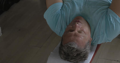 Close-up shot of a man being rather tired with pull over chest exercise Footage