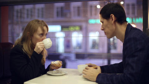 Man and woman drinking tea in the cafe Footage