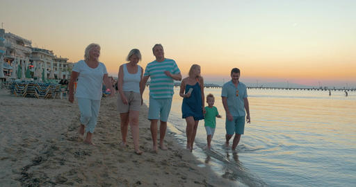 Big happy funny family walks on the beach on sea sunset background Piraeus, Gree Footage