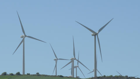 Wind turbines of renewable energy in a hill moving the blades Live Action