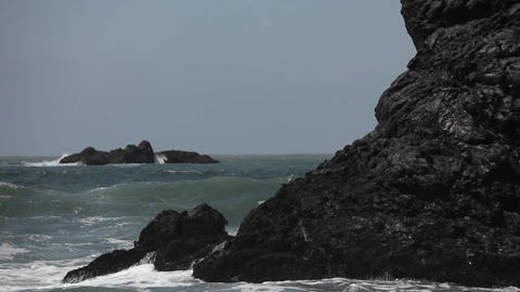 Heavy waves crash onto a rocky shore Stock Video Footage