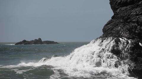Heavy waves crash onto a rocky shore Stock Video Footage