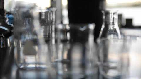 Scientific glass beakers coming into focus Stock Video Footage