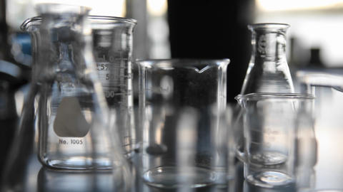 Scientific glass beakers coming into focus Footage