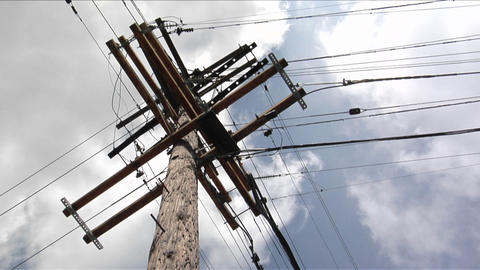 Wires run to a power pole from four directions Stock Video Footage