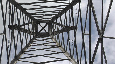 A utility tower climbs into the sky Stock Video Footage
