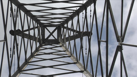 A utility tower climbs into the sky Footage
