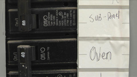A breaker box contains orderly labels Stock Video Footage