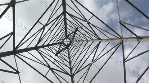 Wires stretch to either side of a utility tower Stock Video Footage