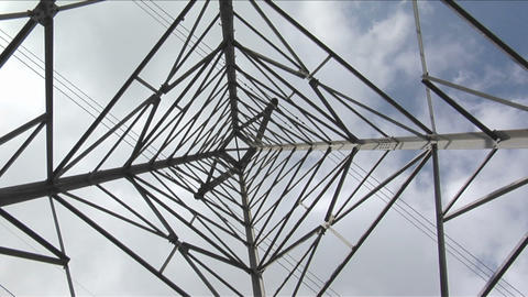 Wires stretch to either side of a utility tower Footage