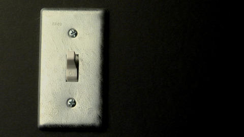 A light switch sits in the on position Footage