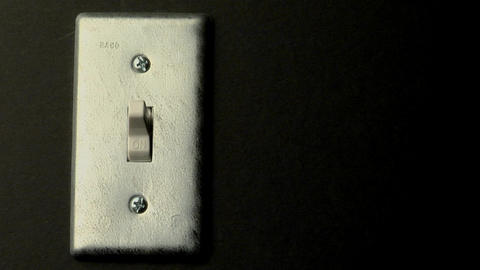 A light switch sits in the on position Stock Video Footage