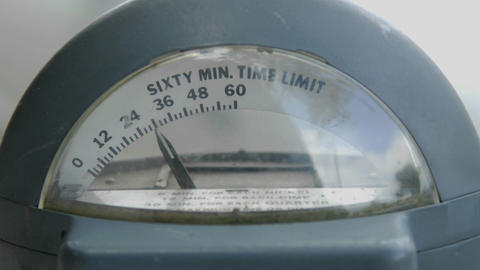 A parking meter slowly counts down to expiration Stock Video Footage