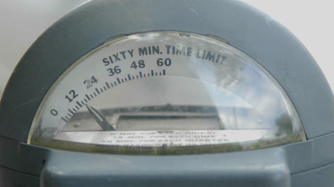 A parking meter slowly counts down to expiration Footage