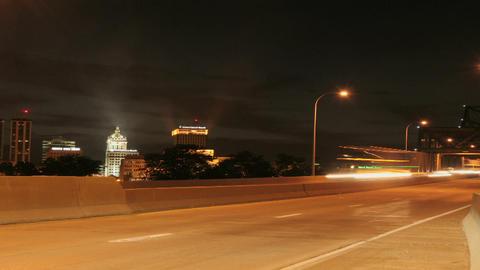 Traffic passes along a city freeway at night Footage