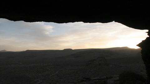 The horizon stretches under a rock outcropping Footage