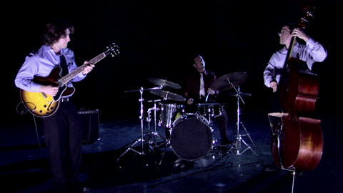 A band plays on a darkened stage Stock Video Footage