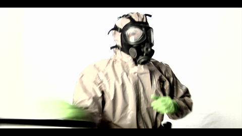 A man in a hazmat suit swings a police baton back Stock Video Footage