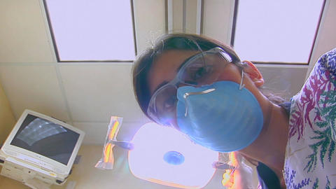 A dental hygienist finishes cleaning a patient's t Stock Video Footage