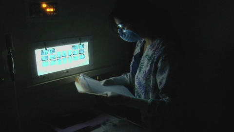 A dental hygienist makes notes from a patient's x- Stock Video Footage