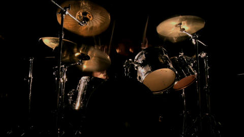 A drummer plays on a darkened stage Stock Video Footage