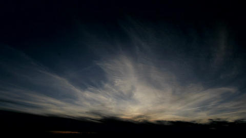 Sheets of wispy clouds blow through the sky Stock Video Footage