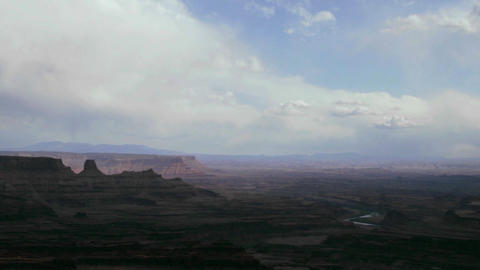 Clouds float above a rugged desert Stock Video Footage